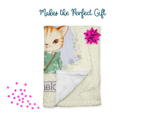 Makes the perfect gift. Yellow cat blanket folded with bow and confetti.