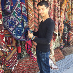 Looking at the beautiful rugs in Cappadocia