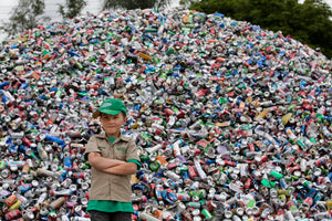 Ryan Hickman posing in front of recycling pile