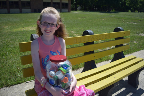 Sammie Vance on buddy bench with recycled plastics.jpg