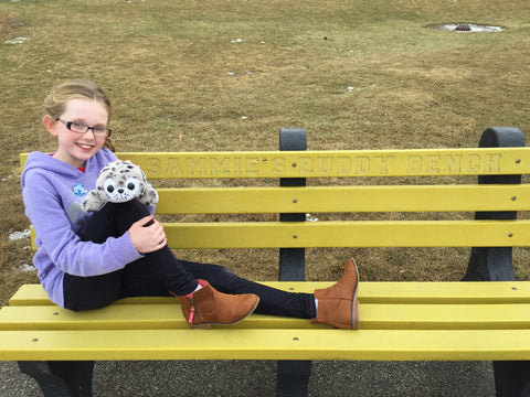Shore Buddies Ocean Hero of the Week: Sammie Vance on her bench with Sammy the Seal.jpg