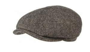 A young classic. On your head this eight-panel cap from Stetson has a felt-soft, fleecy feel. The dark brown newsboy cap is made from an exquisite material blend with high-quality Woolrich® wool and features a classic herringbone pattern. Add a fresh touch your wardrobe with this youthful balloon cap. Features corded lining band and cotton blend lining. Made in Germany.