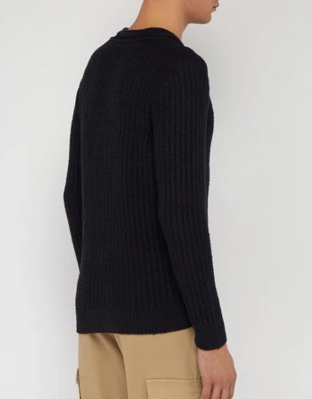 Founded in the Aran Islands in 1976, Inis Meáin continues to employ local people to craft traditional pieces such as this navy sweater made of a linen blend with an element of silk. Made in Ireland, it's cable-knitted and features a chevron pattern crew neckline and a ribbed hem and cuffs.