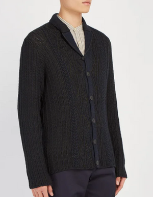 Inspired by clothing developed on the namesake island, Inis Meáin's navy mélange cardigan features a plethora of traditional knitting techniques to achieve its distinctive patterned surface. It's crafted from an insulating linen and cotton-blend with long sleeves and notched lapels, then fastens with matte black buttons.