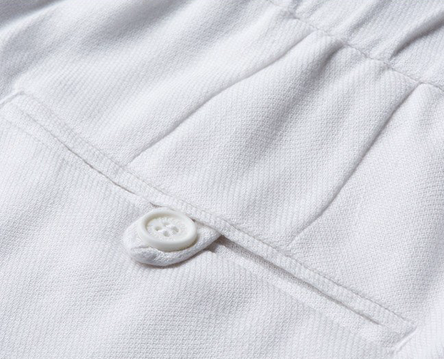 "There isn't a dress code more annoying than ""smart casual"". There isn't a solution more elegant than these white shorts. Breezy linen in a smart cut with a white shade makes these the perfect choice for inbetween dress codes. Pair with a printed t-shirt for a more relaxed take, or stick with a linen shirt for classic Rio."