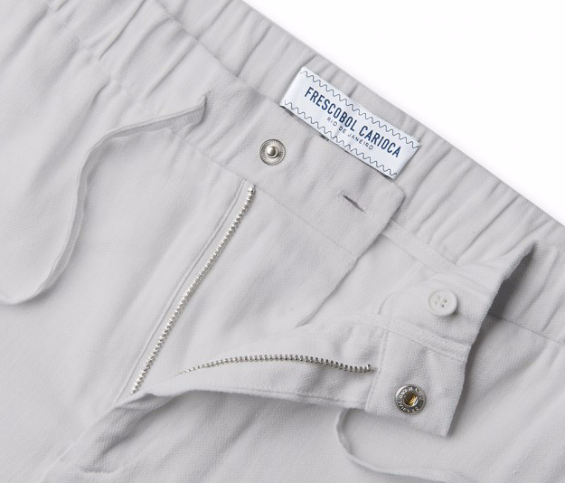 "There isn't a dress code more annoying than ""smart casual"". There isn't a solution more elegant than these mélange blue shorts. Breezy linen in a smart cut with a Light Grey shade makes these the perfect choice for inbetween dress codes."