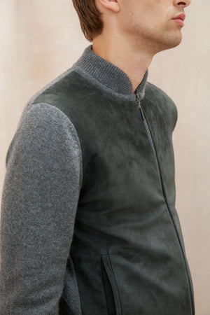 Mid Grey Bomber Style Men's Cashmere Cardigan, combining the softest of cashmere fibres and the finest of Italian suede. Our bomber style grey cashmere cardigan has a full suede front, zip fastening and pocket details to complete the look.
