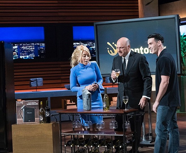 Alexander Simone stands with Lori Greiner and Kevin O'Leary on Shark Tank