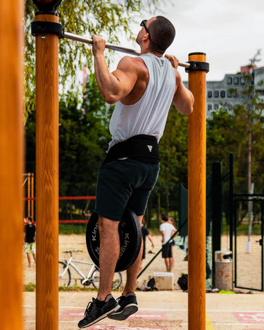 men doing weighted pull ups