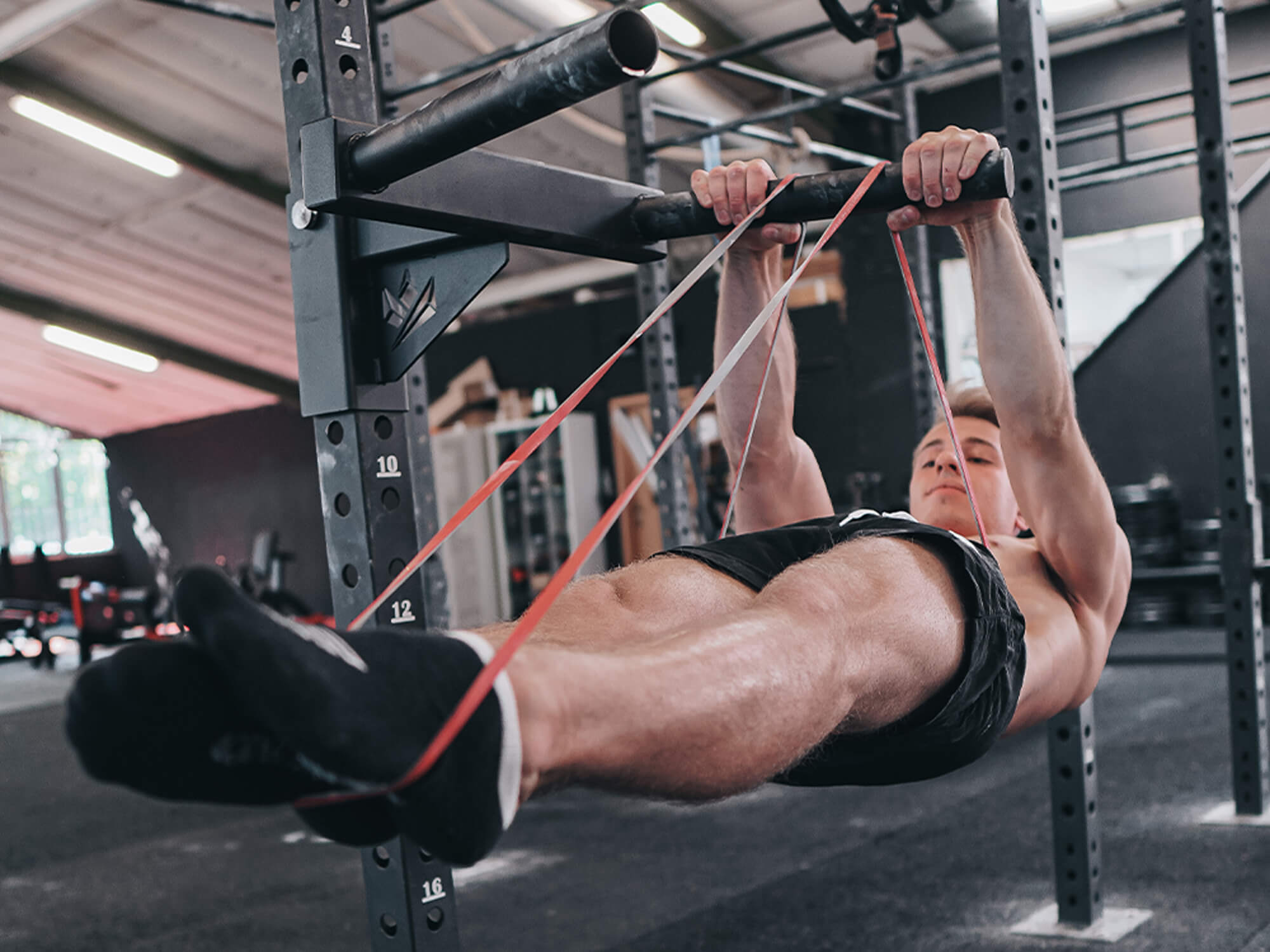 guy performing a front lever with resistance band