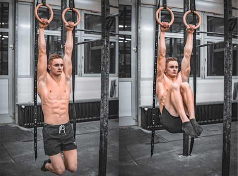 street workout athlete does knee raises on workout rings