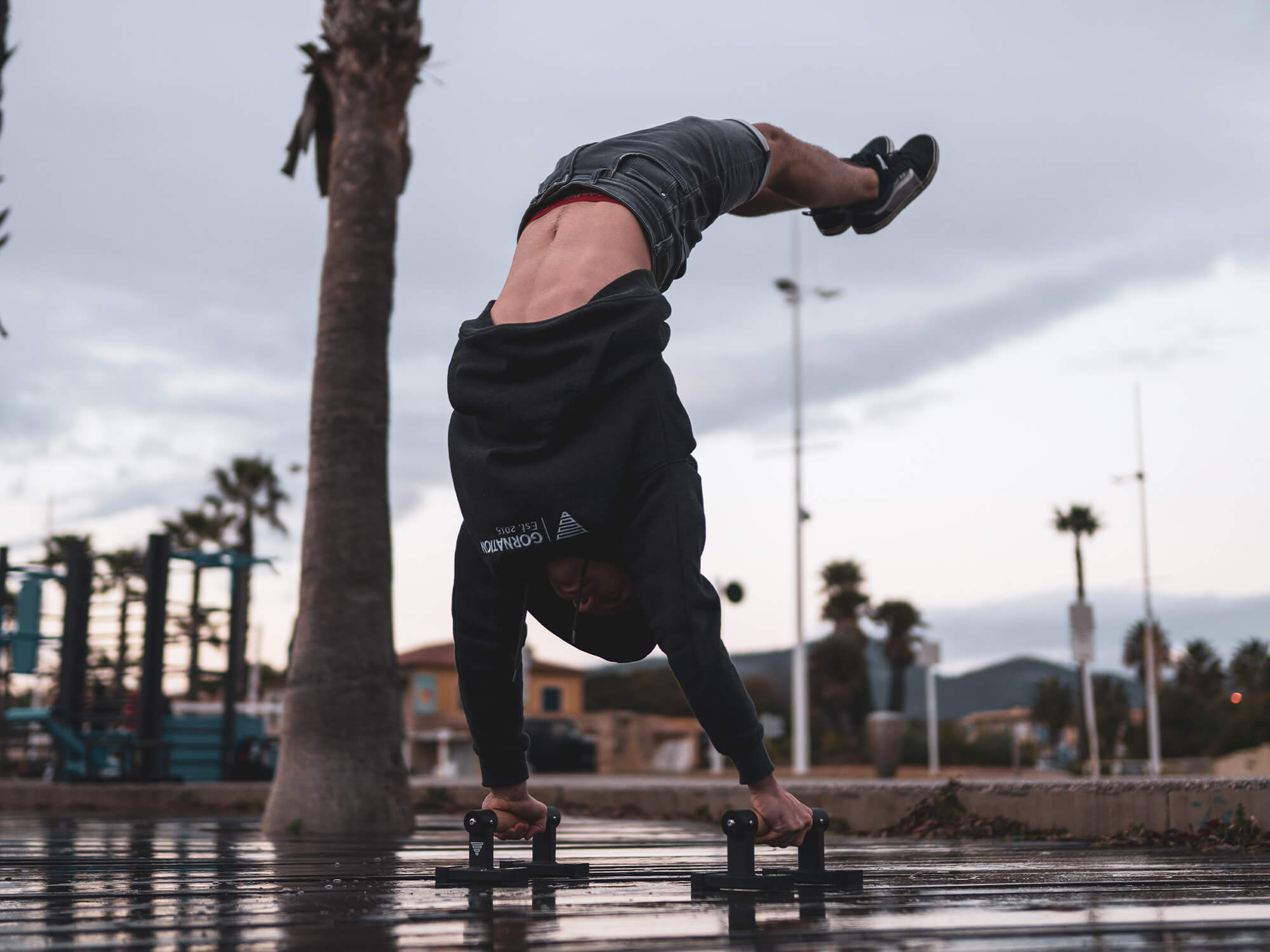 athlete holding a hollow back handstand