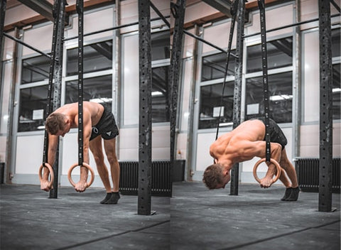 athlete is doing pike push ups on rings