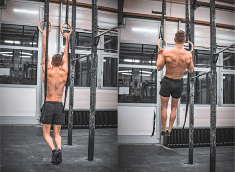 athlete does pull up exercises on rings
