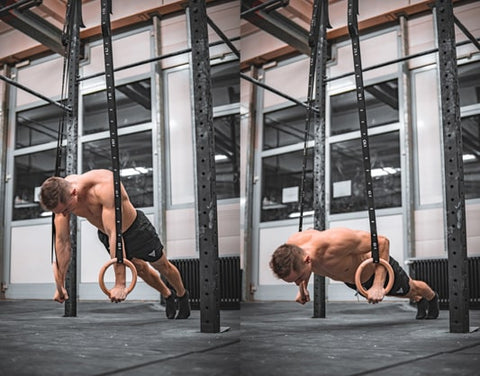athlete does push up exercises on rings in a gym