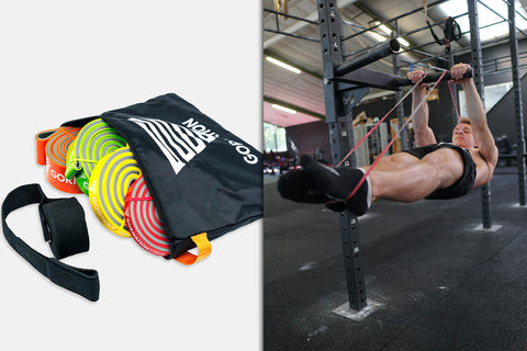 athlete holding front lever with resistance bands