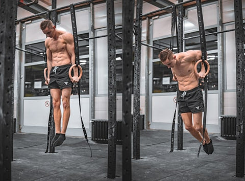 athlete is doing dips exercise on rings