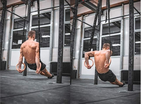 calisthenics athlete does dips on rings in a gym