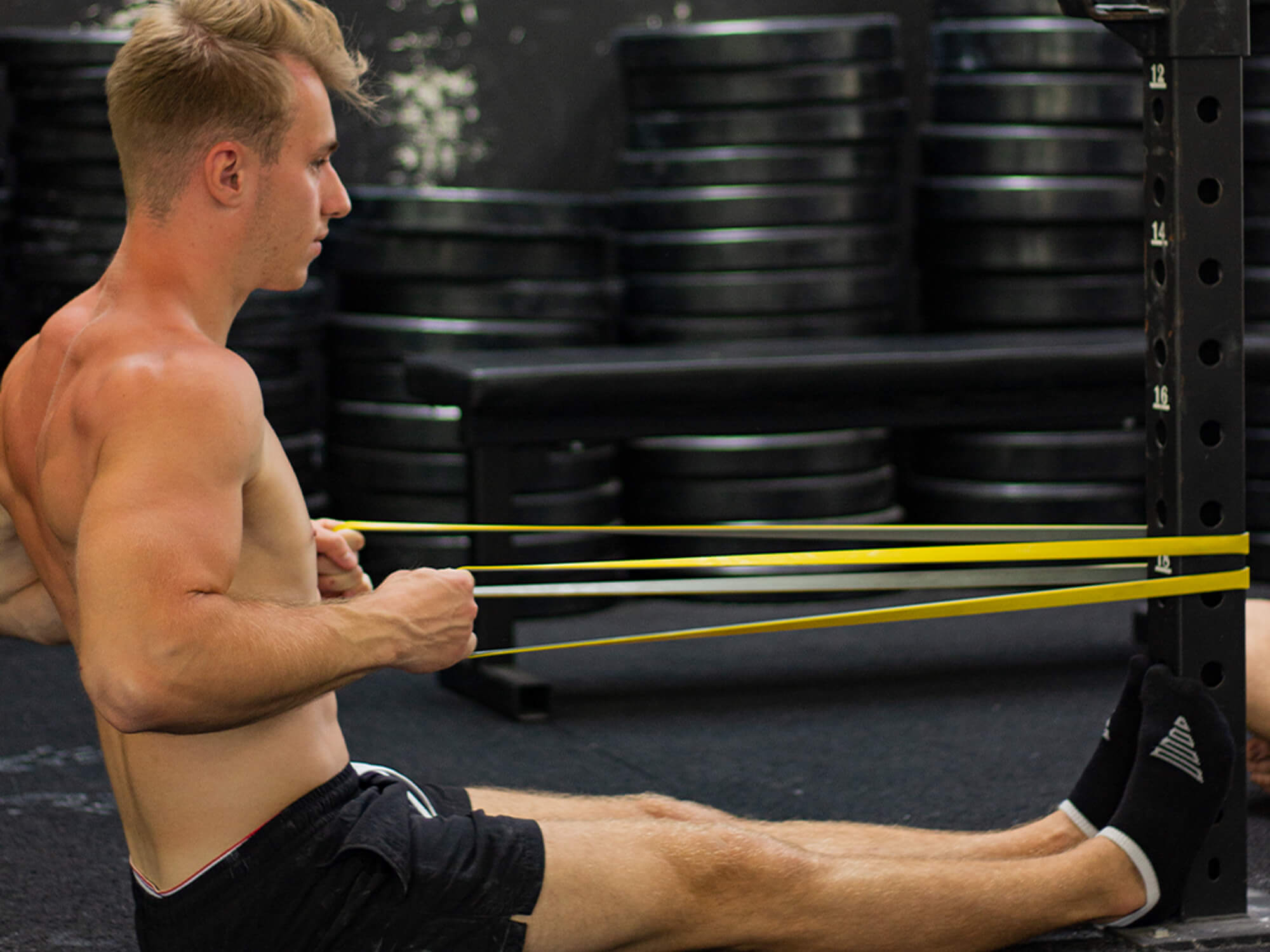 guy doing bodyweight rows with resistance band
