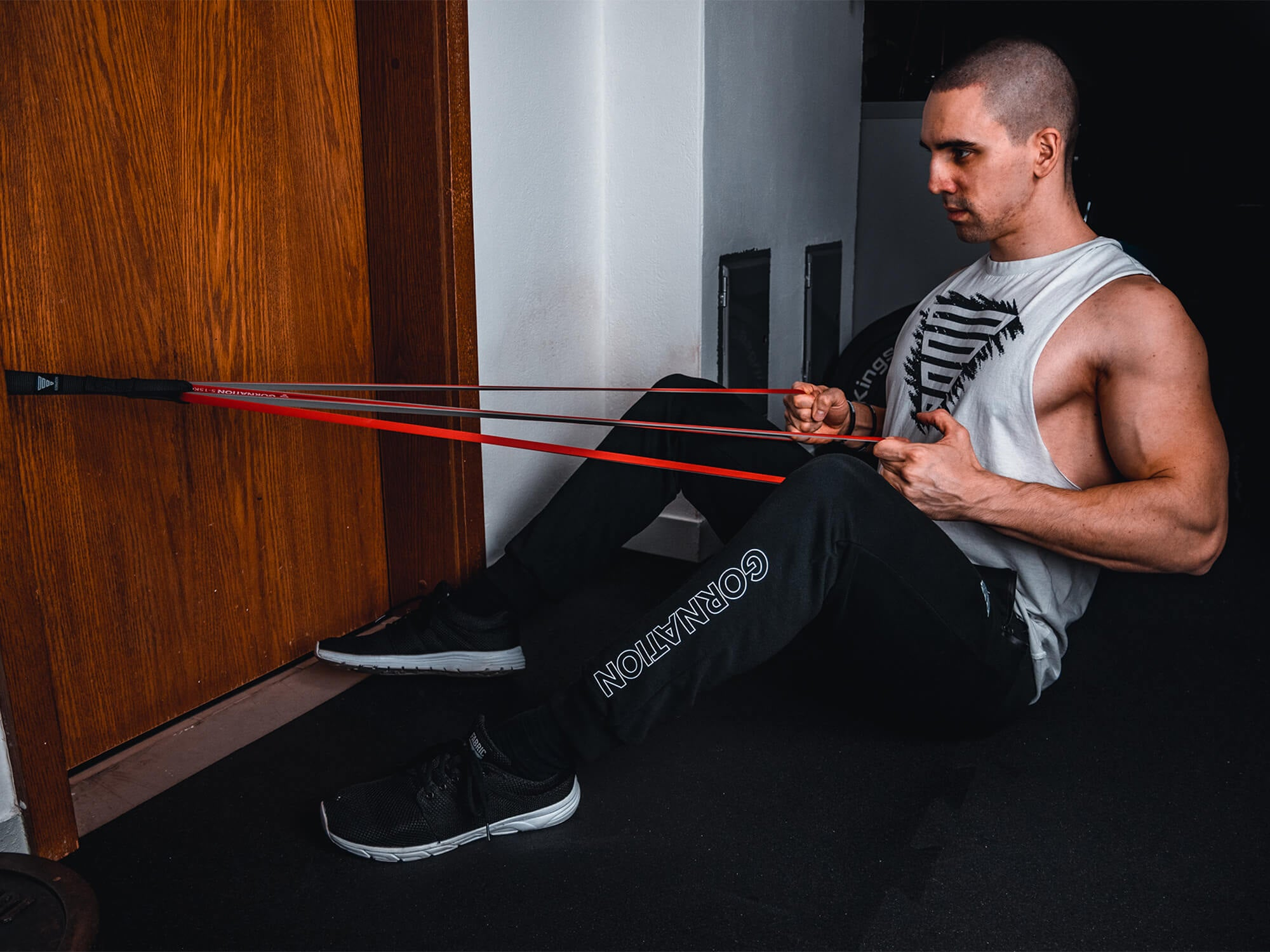 guy doing bodyweight rows with resistance band and door anchor