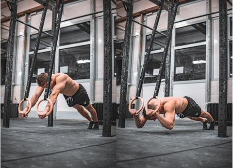 athlete is doing tricpes exercises on rings