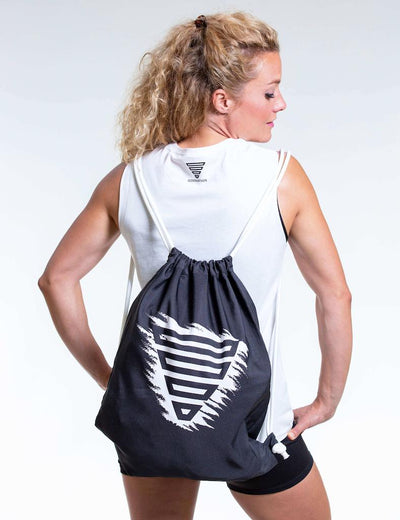 Blonde Model wearing GORNATION Who Cares if your Hands Hurt Tank Top and Vintage Bag in Black