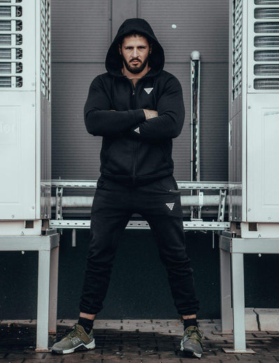 Calisthenics & Street Workout Athlete Vitaly Feschuk wearing GORNATION Zip Hoodie Black and Skinny Sweatpants
