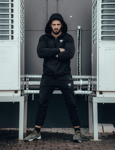 Calisthenics & Street Workout Athlete Vitaly Feschuk wearing Zip Hoodie and Skinny Sweatpants Black by GORNATION