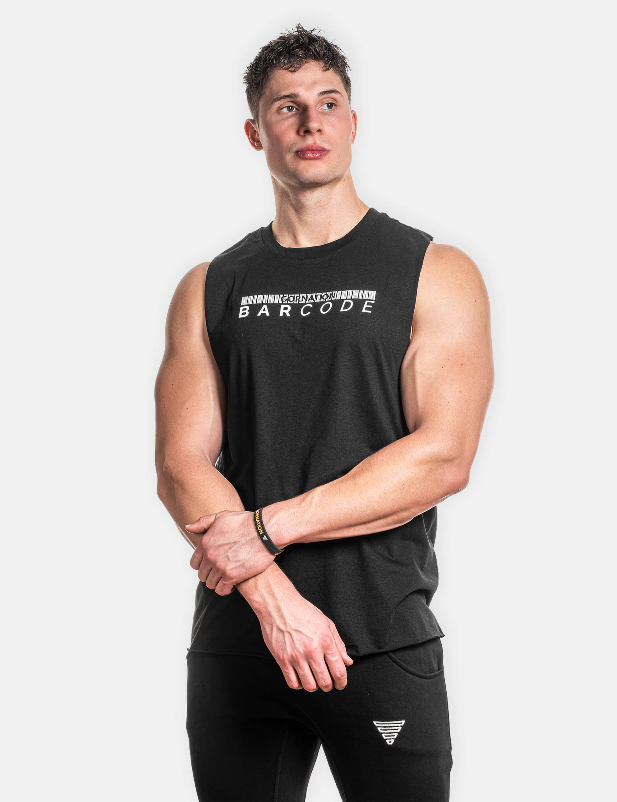 Man wearing loose tank top with the Barcode print. The view is from the front side.