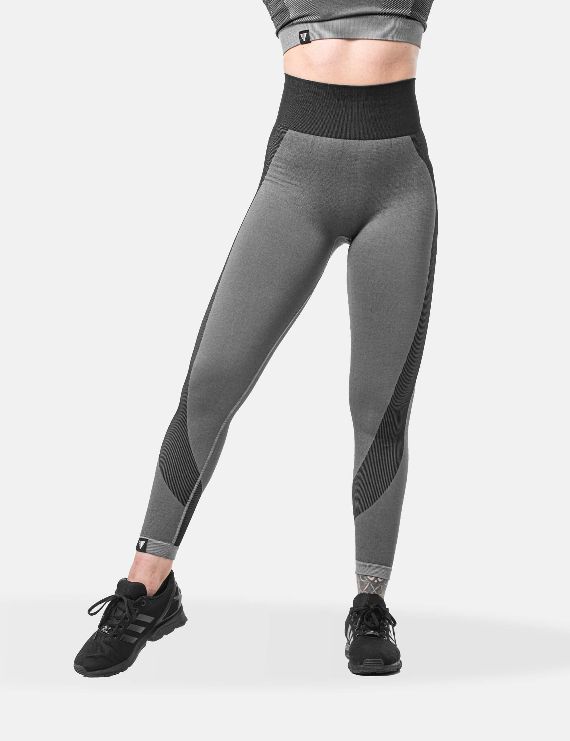 Grey performance legging for woman. Also wearing the performance crop top.