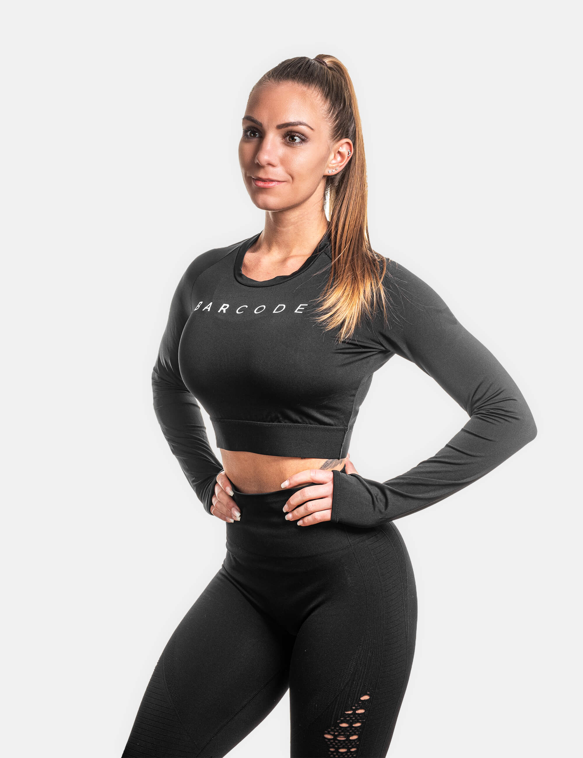 "Woman Crop Top worn by Female Calisthenics athlete. Showing the Text ""Barcode"" at the front."