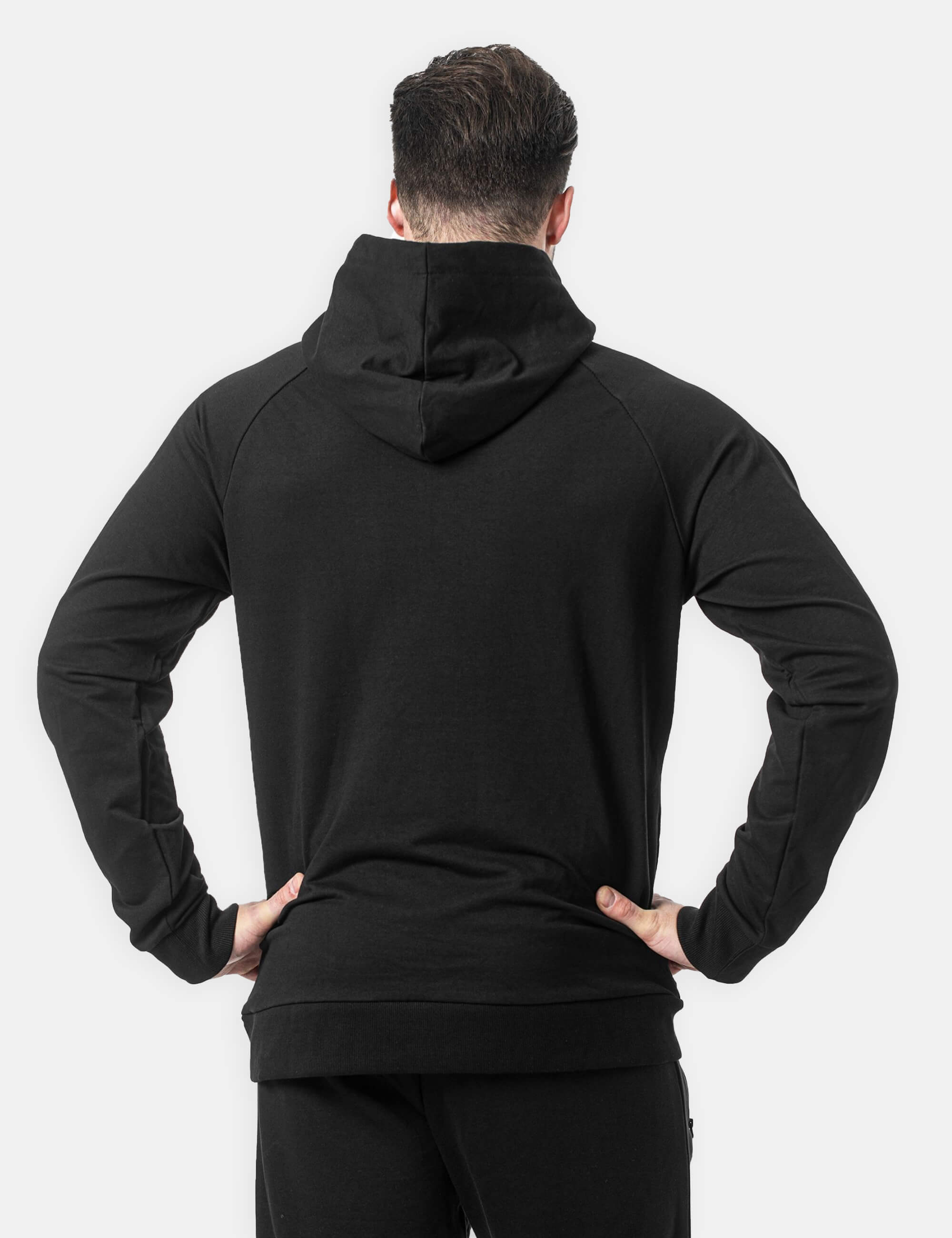 Black hoodie Performance hoodie worn by a male Calisthenics athlete. front view.