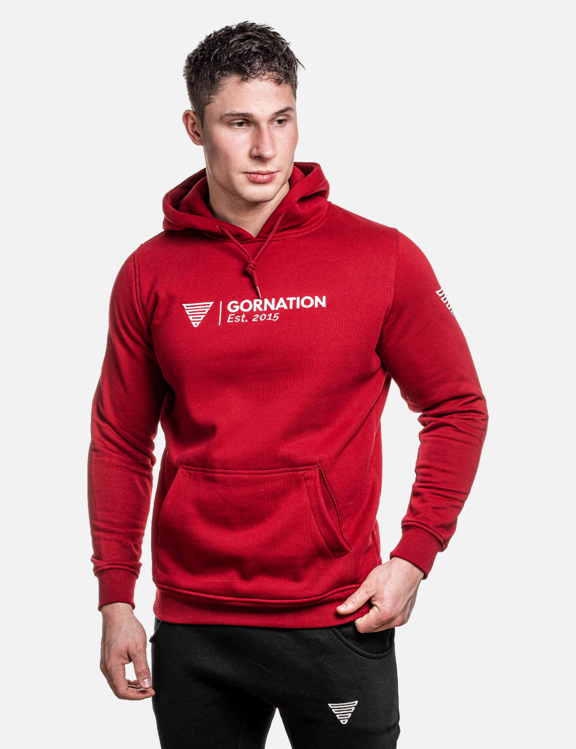 Calisthenics Athletes presents the front side of the red Anniversary hoodie from Gornation showing the text and logo.