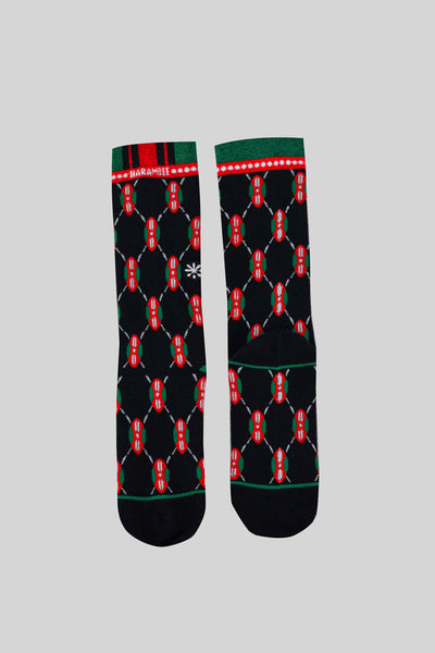 Black, green, and red socks with a Maasai shield, inspired by Kenya