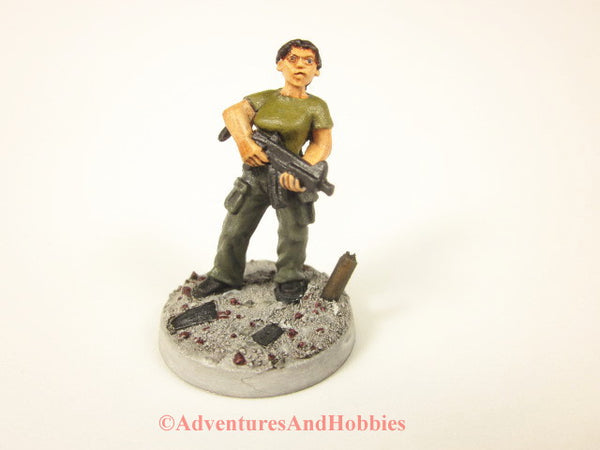 Painted miniature female soldier in a post apocalyptic zombie world 25mm scale figure.