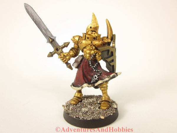 Golden knight in full armor for Rackham's Confrontation miniature game.