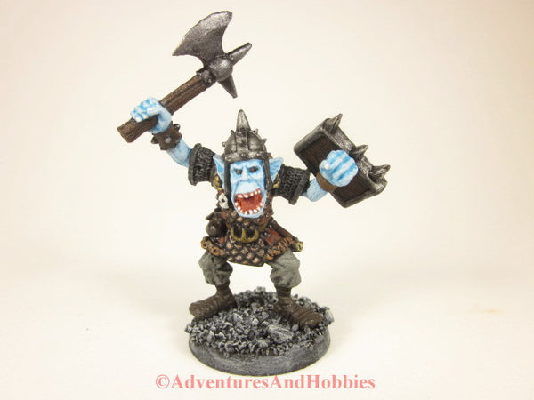 Fantasy miniature ice orc warrior with axe 25-28mm scale figure for wargames and role-playing games.