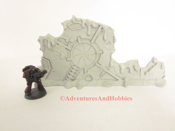 Unpainted battle damaged star ship bulkhead scenery piece for 25 to 28mm scale table top war games.