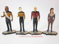 Set of 4 crew members figures from Star Trek: The Next Generation.