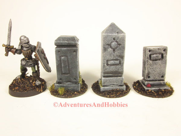 Set of 3 miniature graveyard headstone monuments T1543 for 25-28mm scale table top wargames and role-playing games.