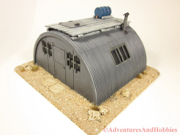 Miniature zombie apocalypse desert refuge T576 reinforced quonset hut scenery piece for 25-28mm scale table top wargames.