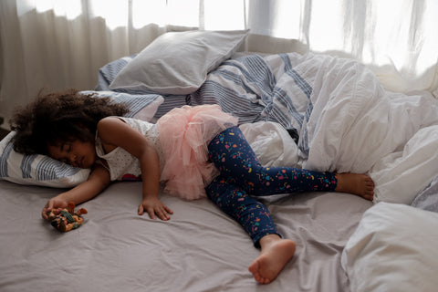 Young girl napping in tutu