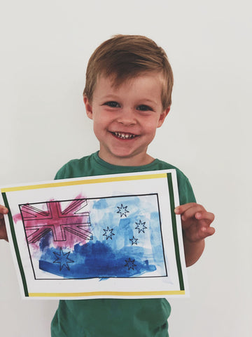 Little boy with finished artwork