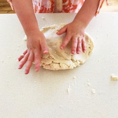 Child kneading playdough