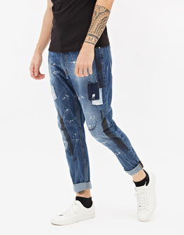 Jeans regular con strappi