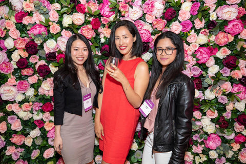 three women in front of femmepire flower wall