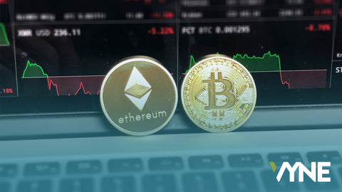 ethereum and bitcoin gold coin on macbook
