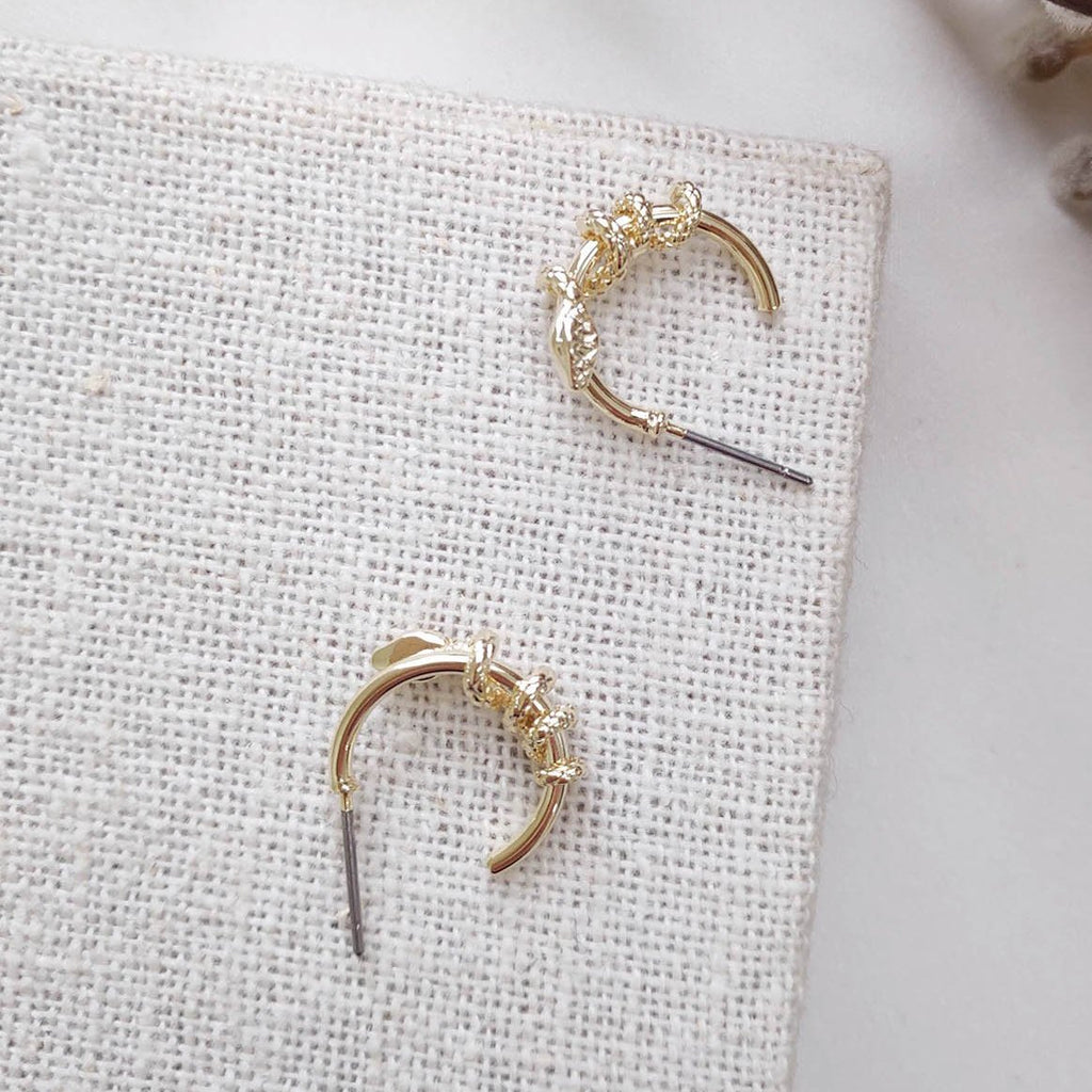 Small gold hoop earring with snaker wrapped feature