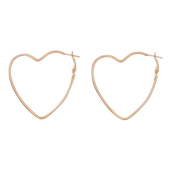 Sweetheart shaped gold statement earrings by Mint and moss