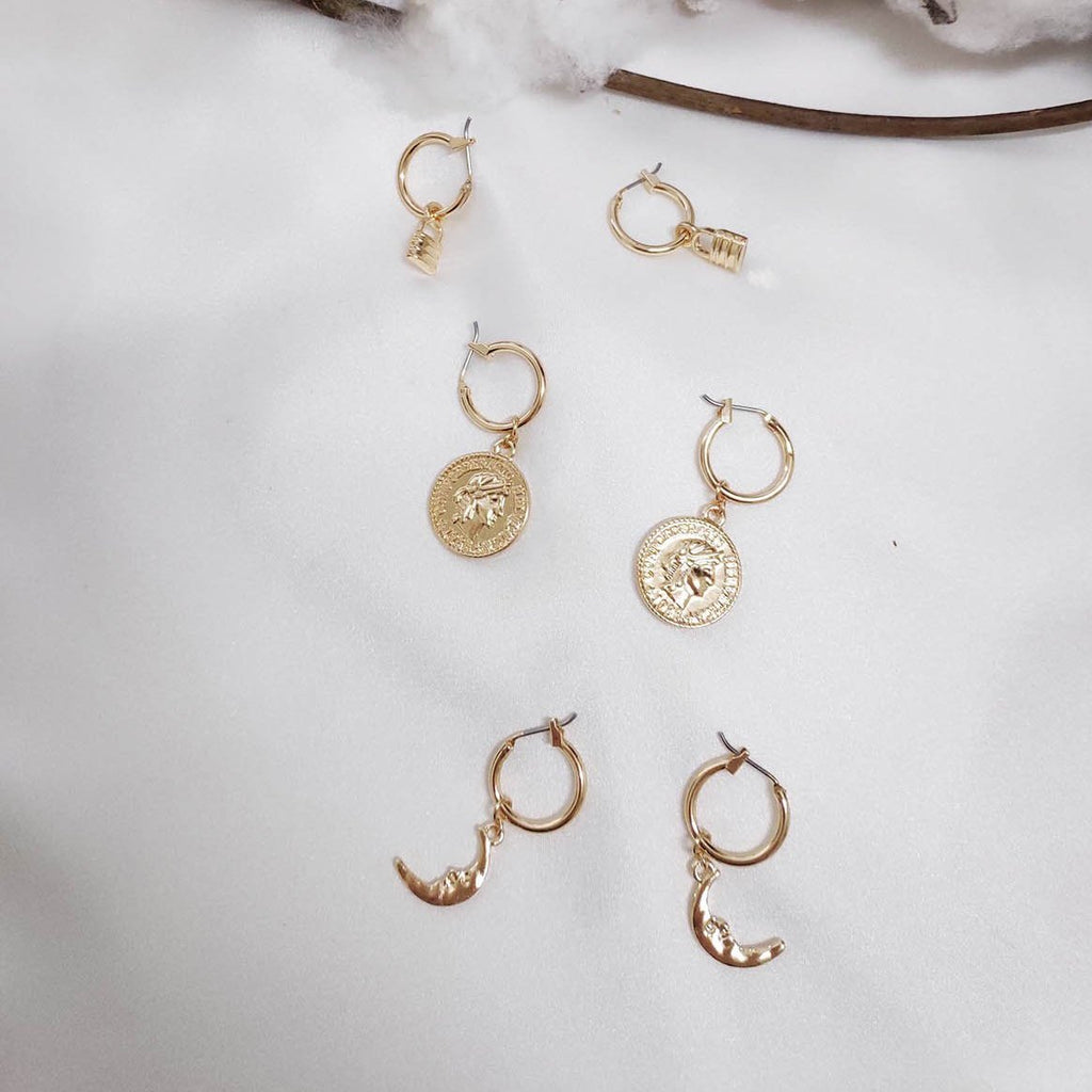 A trio of gold hoop earrings